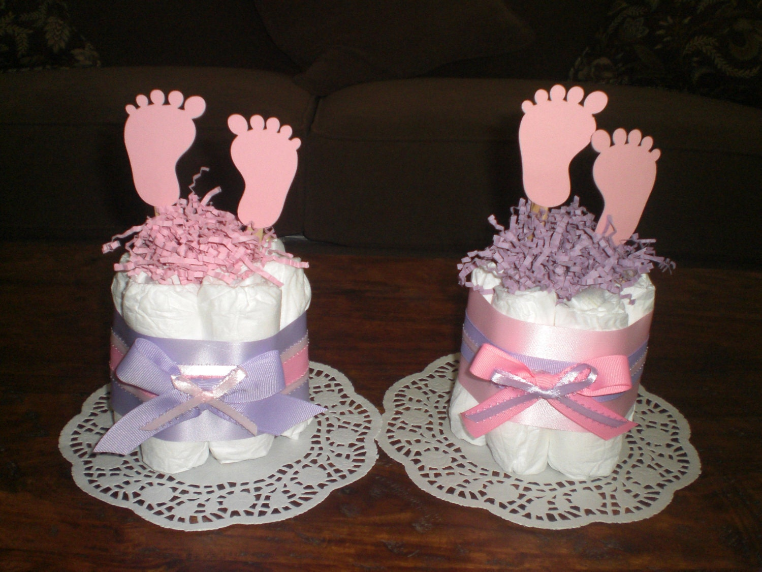 Baby feet diaper cake baby shower centerpieces other sizes and for Baby footprints cake decoration