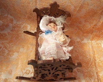 doll  house cradle and doll