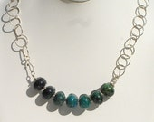Evolvere, handmade azurite bead, wirewrapped sterling silver necklace