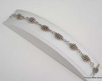 "Serious Silver,  handmade all sterling silver ""kouchie coiled"" , heavy weight bracelet"