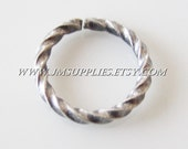 10mm, 16 Gauge Antiqued Silver Fancy Round Jumpring