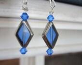 Sapphire Framed in Silver . earrings .