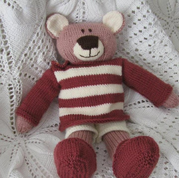 Knitted dressed teddy bear in pink dressing up plush doll