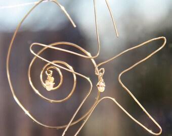 starfish and nautilus dangle earrings