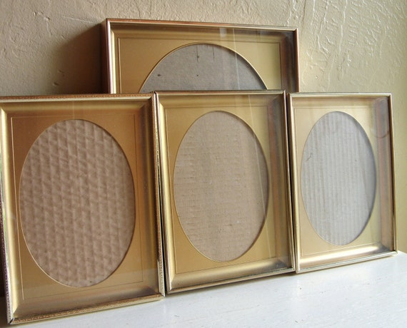 Set of Matching Vintage Gold Metal Shadow Picture Frames with Oval Matting