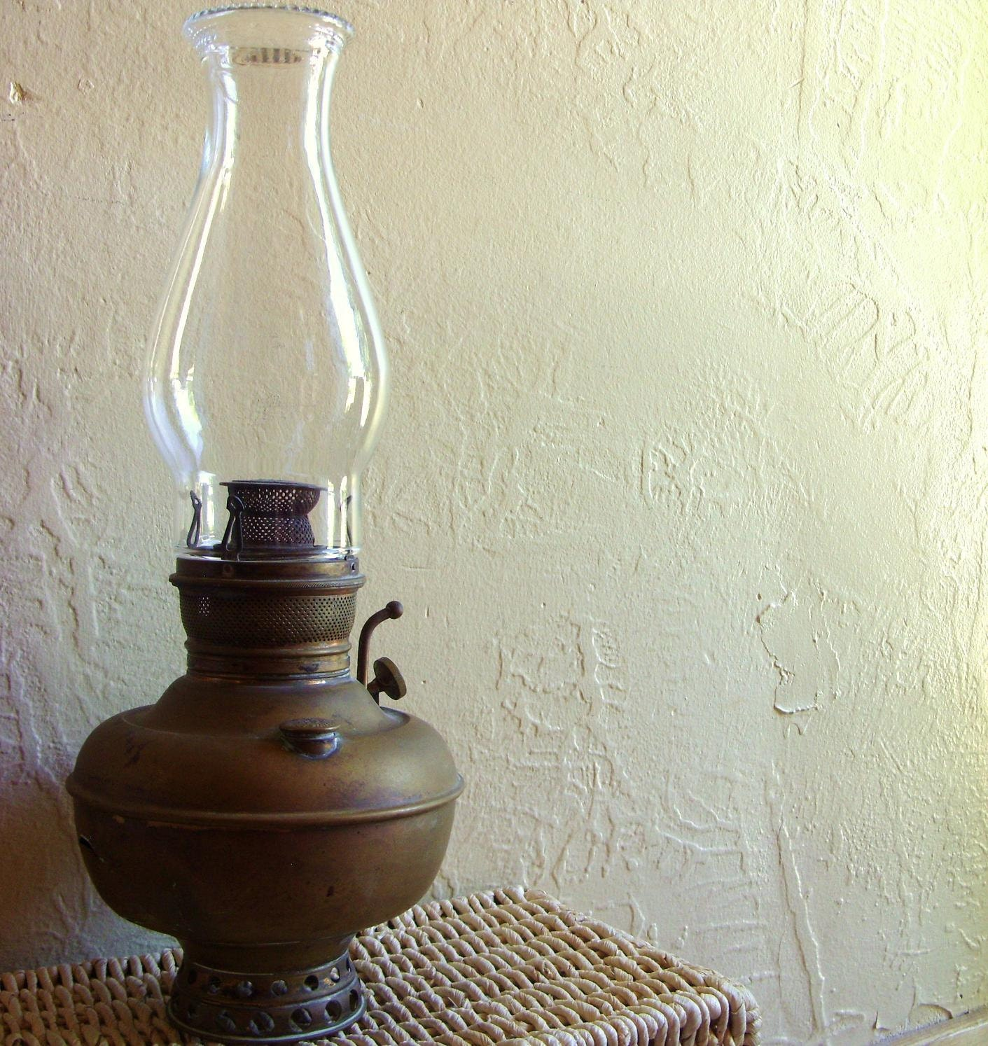 antique juno brass oil lamp with glass globe in tact. Black Bedroom Furniture Sets. Home Design Ideas