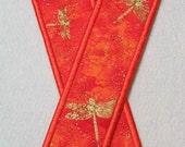 Orange bookmark with gold dragonflies