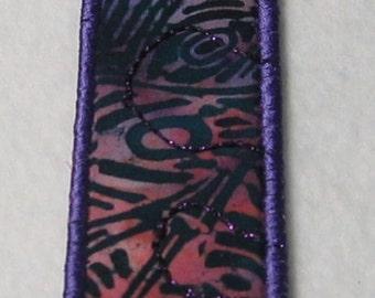 Dark purple tribal-style bookmark
