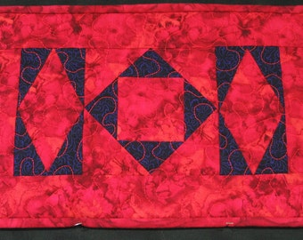 Red and purple batik diamonds placemat