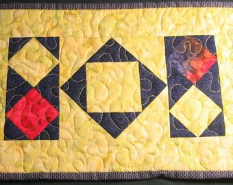 Yellow, purple and red batik diamonds placemat