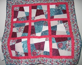 Burgundy, teal, pink and white crazy nine-patch lap quilt