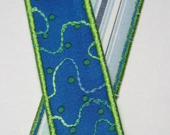 Deep sea blue bookmark with green trim
