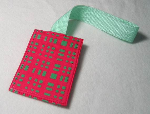 Neon pink and green luggage tag