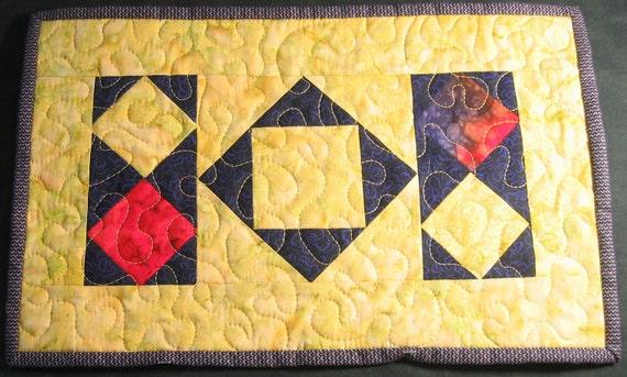 Yellow, purple and red batik diamonds placemat