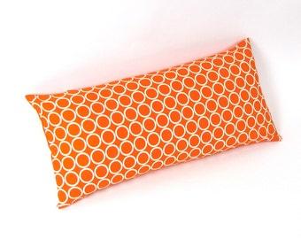 "Ivory Circles on Orange Pillow 8"" x 17"""