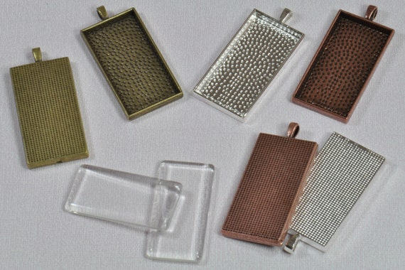 "20 pcs 1"" x 2"" Rectangle Pendant Trays with Rectangle Glass Choose from Bronze, Antique Copper and Silver Plated.  Size is 1"" x 2"""