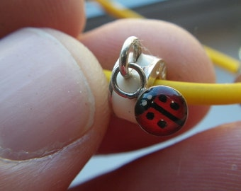 Silicone and Sterling Enamel lady bug Bracelet.