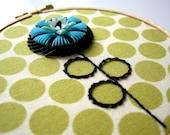 green polka dot flower