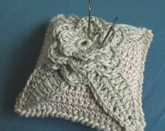 Crochet pincushion in pastel tones - light grey and light green