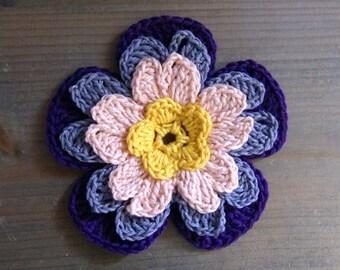 Crocheted applique four-colors flower