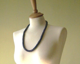 One crocheted strand with beads in Blue (OR Green). Can be as necklace or braslet