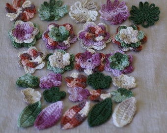 Set of 23 crocheted applique multicolor flowers and 5 leaves