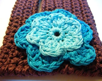 Crochet claret handbag with blue flower