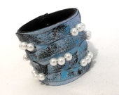 Wide blue leather bracelet with beads