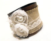 Fashion leather bracelet with lace flowers. Leather jewelry