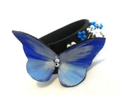 Narrow leather bracelet with blue butterfly
