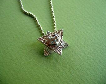 small modern silver jewish star necklace