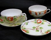 Two Hand-painted Moriage Teacups and Saucers
