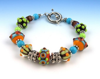 Colorful bumpy bead bracelet | Southwestern jewelry, lampwork and Bali silver beads with toggle clasp