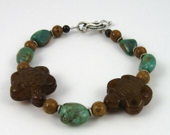 Turtle bracelet, turquoise nugget and carved jade beads with sterling silver toggle clasp