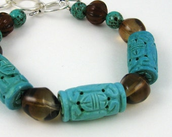 Turquoise and Brown bracelet, glass and carved gemstone beads with adjustable sterling silver toggle clasp