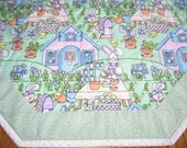 """Quilted Octagon in an Easter Village Pattern - 22 """" diameter"""