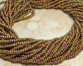10/0 Metallic Gold Iris AB Czech Glass Seed Bead Hank