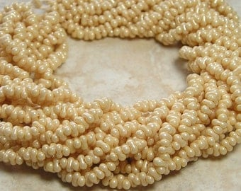 4x2mm Opaque Eggshell Czech Glass Farfalle Seed Bead Strand (AW103)