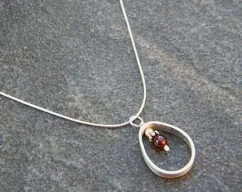 Sterling Silver Teardrop Framed Garnet Necklace
