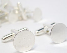 16 Shiny Silver Tone Cufflink Blanks.  Contact us if you would like other quantities.