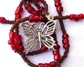 Delicate brown and red necklace with butterfly
