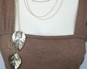 Silver plated Hibiscus leaves necklace on multichain gold silver chains