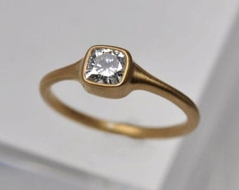 0.50 carat tapered cushion diamond solitaire engagement ring | 18k gold