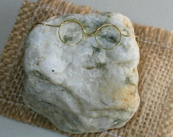 Pet rock wearing glasses with naturally formed features