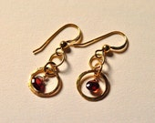 Ancient charm - gold filled earrings with beaten circles and almandine garnets