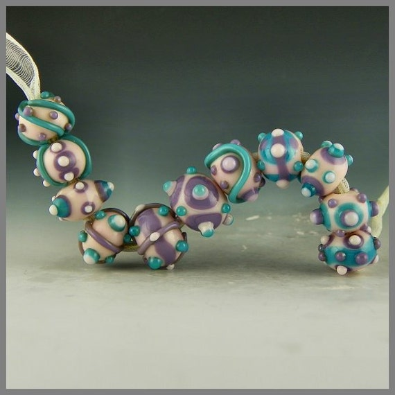 a set of 11 handmade lampwork beads combining pastel purple, pink, and turquoise - Baby Soft