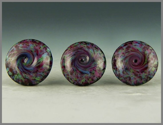 a set of three handmade lampwork glass buttons in a swirled pink/green/blue frit pattern - 3 Pinwheels