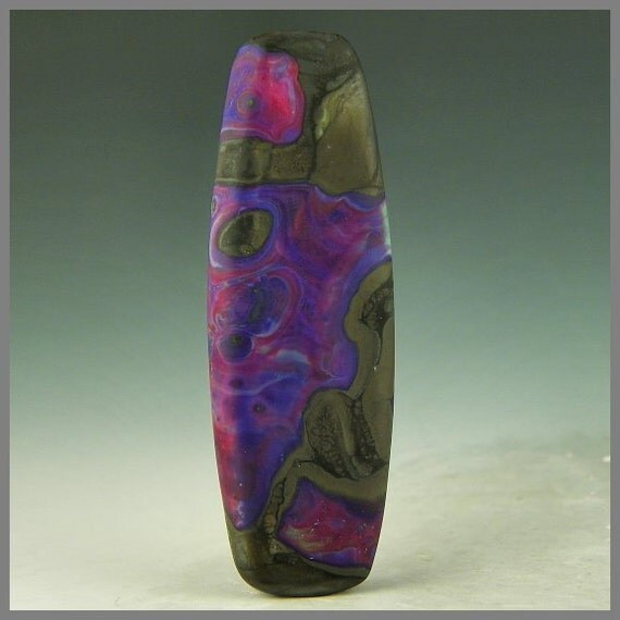 a long etched handmade lampwork tab focal bead in purple, red, and black - Purple Monolith
