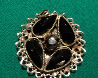 Black and goldtone pendant