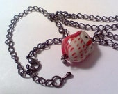 Red porcelain red cutsey owl on gunmetal adj. up to 19 inch necklace